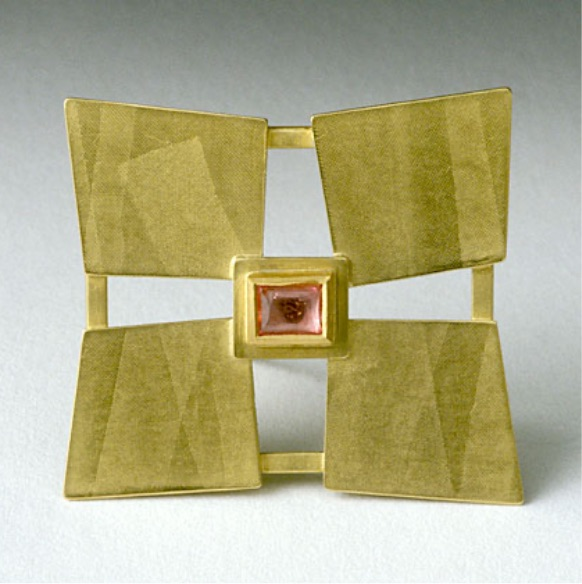 Gold brooch made of diamond shaped leaves of gold