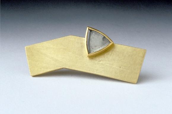 Angular Gold pin with a triangular stone
