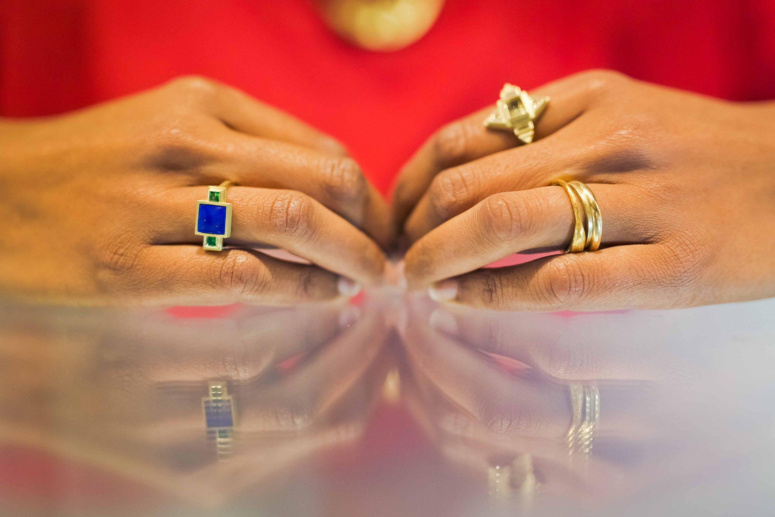 Hands showcasing rings
